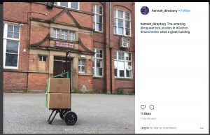 Instagram post from @hannah_directory showing 2 cardboard boxes outside the front of a building
